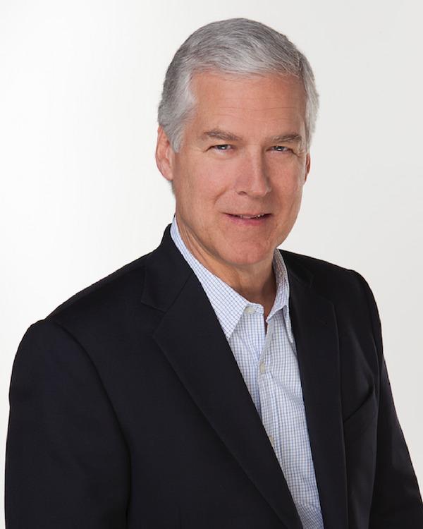 Portrait photo of a man in a suit