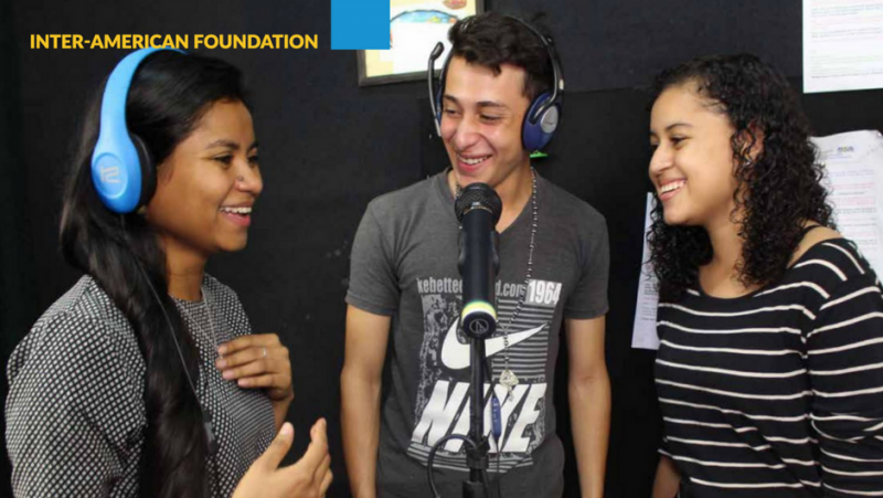 Cover of the IAF 2017 Annual Report featuring a photo of three young people smiling around a microphone