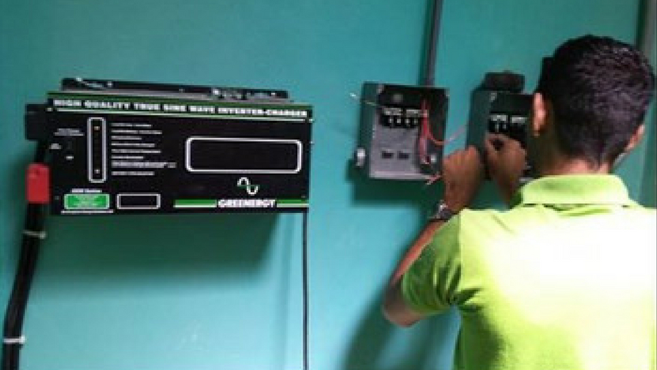 a man working on an electric box