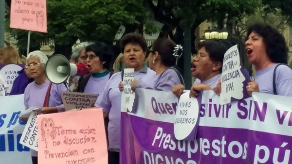 A group of women protesting with signs and a banner