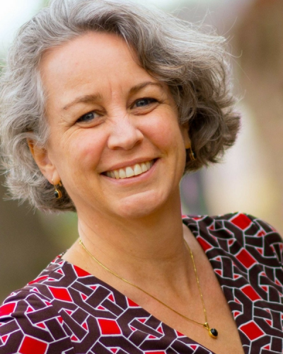 portrait of a woman with grey hair and a colorful top