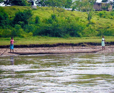Two women guide a boat down a Nicaraguan river