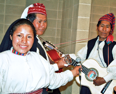Three Peruvians from Taquile display their instruments.