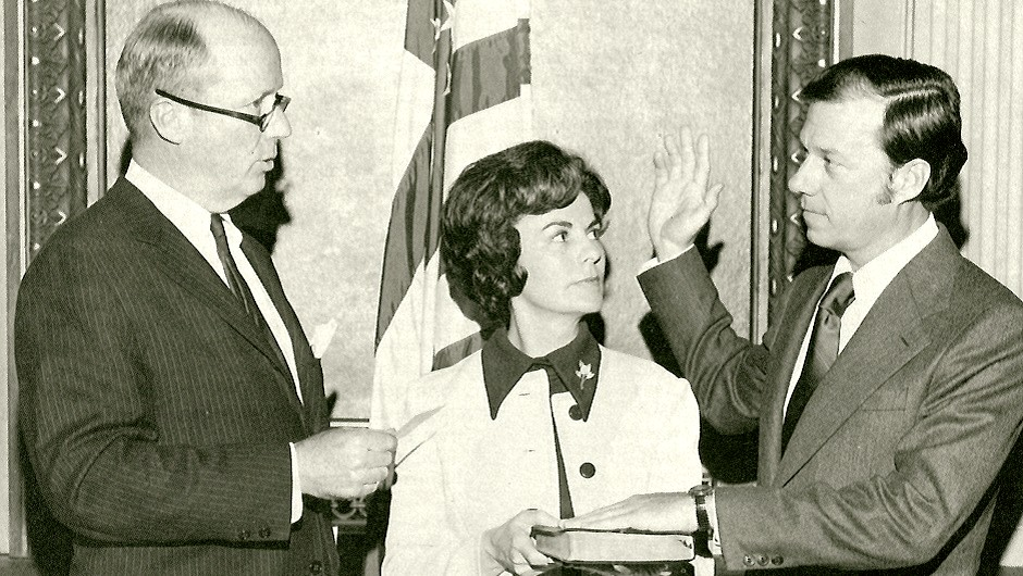 William Dyal, the IAF's first president, is sworn in by augustin Hart Jr., the IAF's first board chair.