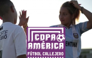 Two young people participate in a Copa America street soccer tournament.