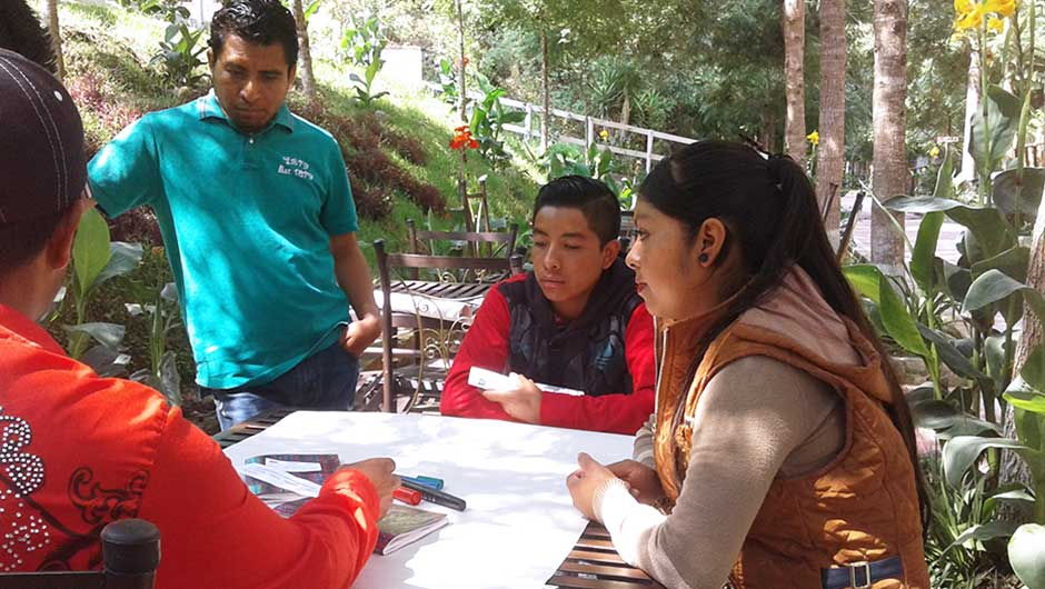 IAF grantee partners have a brainstorming session in the woods.
