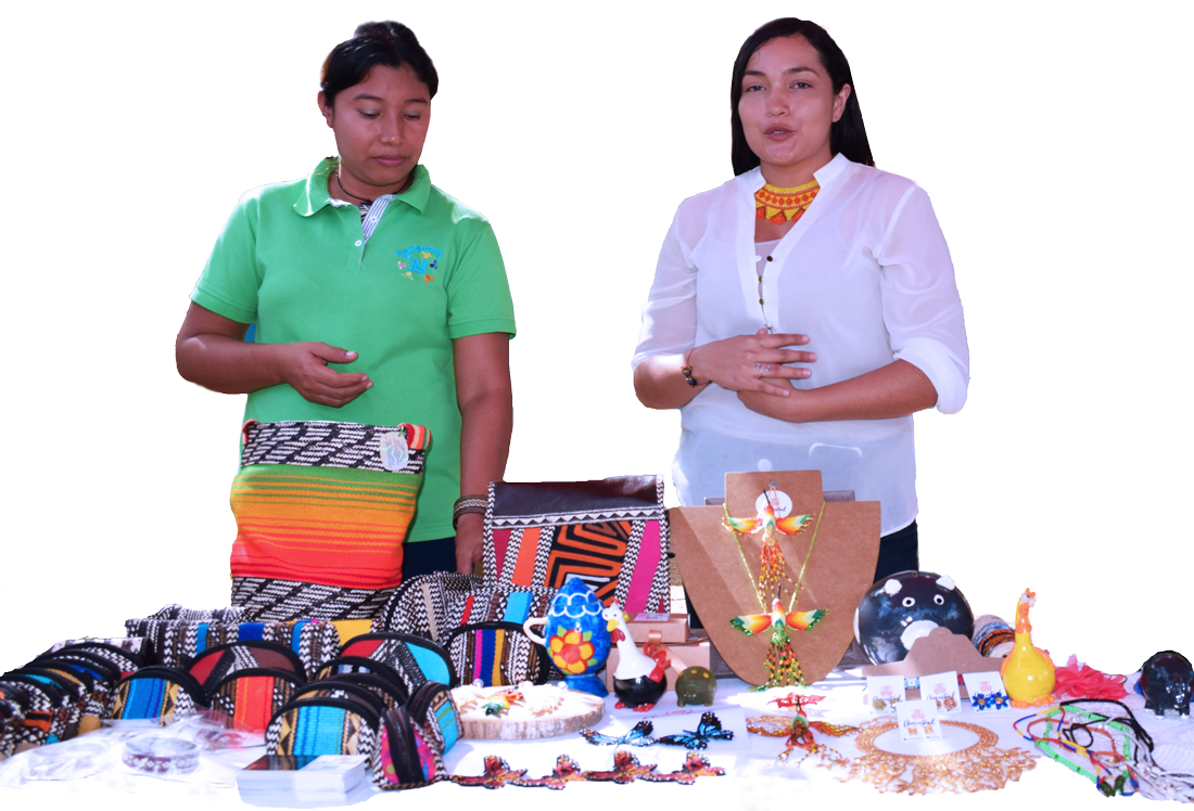 Two Colombian women and small business owners sell handmade jewelry at an outdoor booth.